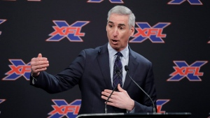 In this Feb. 25, 2019, file photo, XFL Football Commissioner Oliver Luck talks to reporters before introducing former NFL football quarterback Jim Zorn as the head coach for Seattle's XFL football team, in Seattle. (AP Photo/Ted S. Warren, File)