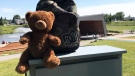 Heidi Erickson found this teddy bear inside a backpack left on a post at a park in Airdrie, Alta. (Heidi Erickson / Facebook)
