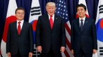 In this July 6, 2017, file photo, U.S. President Donald Trump, center, meets with Japanese Prime Minister Shinzo Abe, right, and South Korean President Moon Jae-in before the Northeast Asia Security dinner at the U.S. Consulate General Hamburg in Germany. (AP Photo/Evan Vucci, File)