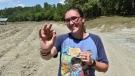 Miranda Hollingshead of Bogata, Texas, with the 3.72-carat yellow diamond she found in Arkansas's Crater of Diamonds State Park. (Arkansas State Parks)