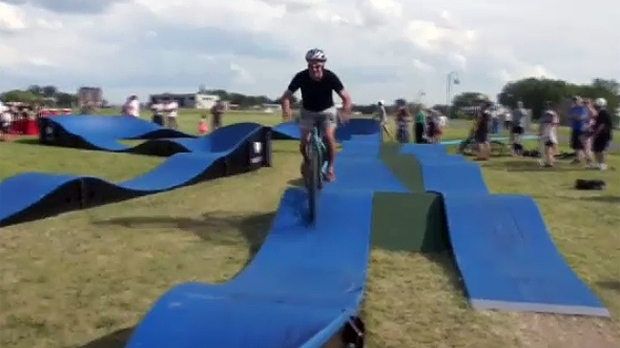 The idea behind a pumptrack is that you pedal less and use your body weight to gain speed.