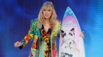 In this Aug. 11, 2019 file photo, Taylor Swift accepts the Icon award at the Teen Choice Awards in Hermosa Beach, Calif. Swift plans to re-record her songs after her catalog was purchased by popular music manager Scooter Braun. (Photo by Danny Moloshok/Invision/AP, File)