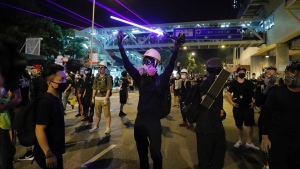 Demonstrators shine laser pointers outside the Yuen Long MTR station during a protest in Hong Kong, Wednesday, Aug. 21, 2019. (AP Photo/Kin Cheung)