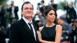 "FILE - In this May 18, 2019 file photo, film director Quentin Tarantino and his wife Daniela Pick pose for photographers upon arrival at the premiere of the film ""The Wild Goose Lake"" at the 72nd international film festival, Cannes, southern France. (Photo by Arthur Mola/Invision/AP, File)"