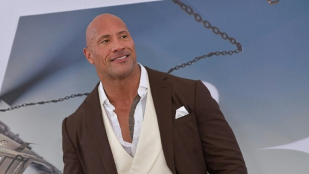 Actor Dwayne 'The Rock' Johnson uses his A-list clout to secure lucrative profit-sharing movie deals on top of eight-figure fees. (AFP)