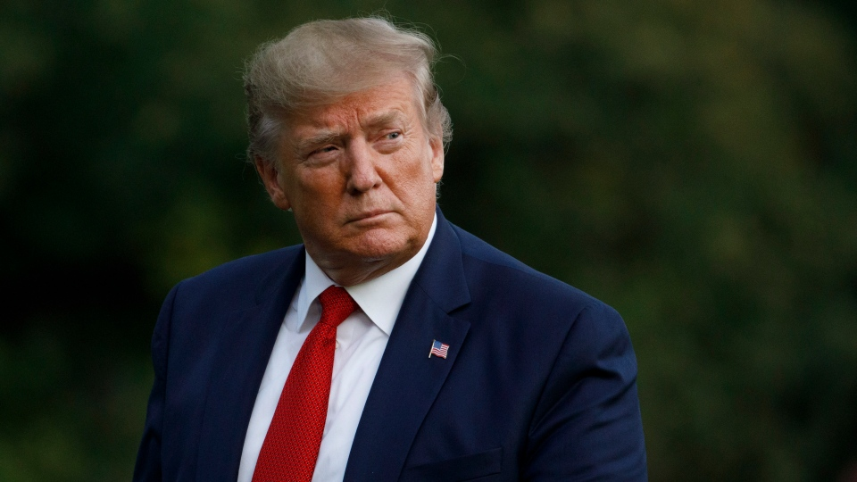 U.S. President Donald Trump arrives at the White House in Washington, Wednesday, Aug. 21, 2019, as he returns from Louisville, Ky. (AP Photo/Carolyn Kaster)