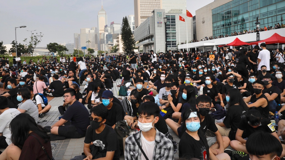 Students and others gather during a demonstration at Edinburgh Place in Hong Kong, Thursday, Aug. 22, 2019. (AP Photo/Vincent Yu)