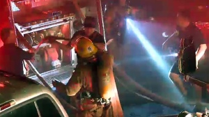 Firefighters on Cartier St. in Montreal prepare to battle a kitchen fire