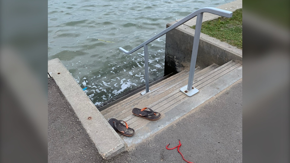 Palwinder Singh's sandals remained on the shore of Sylvan Lake Thursday morning, the day after he failed to surface after falling off an inner tube