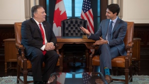 Canadian Prime Minister Justin Trudeau gestures to US Secretary of State Mike Pompeo as they speak on Parliament Hill in Ottawa, Thursday August 22, 2019. THE CANADIAN PRESS/Adrian Wyld