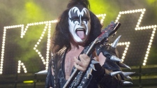 Gene Simmons, bass player for the band Kiss, performs in Holmdel, N.J., on Tuesday, July 20, 2004. (AP / Christopher Barth)