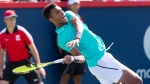 Felix Auger-Aliassime of Canada loses his balance as he returns to Karen Khachanov of Russia during round of sixteen play at the Rogers Cup tennis tournament Thursday August 8, 2019 in Montreal. THE CANADIAN PRESS/Paul Chiasson