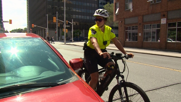 Ottawa police and parking control officers patrolling on e-bikes