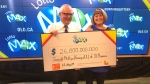 Gerry and Helen Phillips of St. Thomas, Ont. pick up their $26-million cheque in Toronto, Ont. on Thursday, Aug. 22, 2019. (Source: OLG)