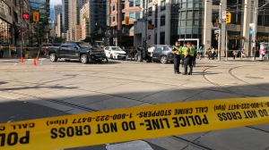 Emergency crews attend the scene of a multi-vehicle crash near Bay and College streets on Aug. 22, 2019. (Toom Podolec/CTV News Toronto)