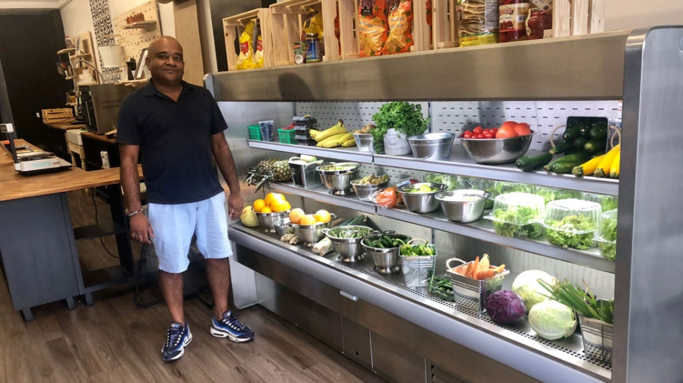 Doodle's Market owner Kamar Shah has installed special metres and phone alerts to advise him when his refrigeration systems shut down due to a power outage. (Natalie Johnson/CTV News Toronto)