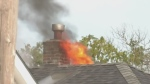 Challenging fire destroys east London home