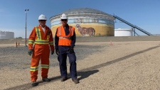 Artist Grant McLaughlin, left, with Project Manager Barry Sudom, right, in front of the Enbridge Mural. (Marc Smith / CTV Regina).