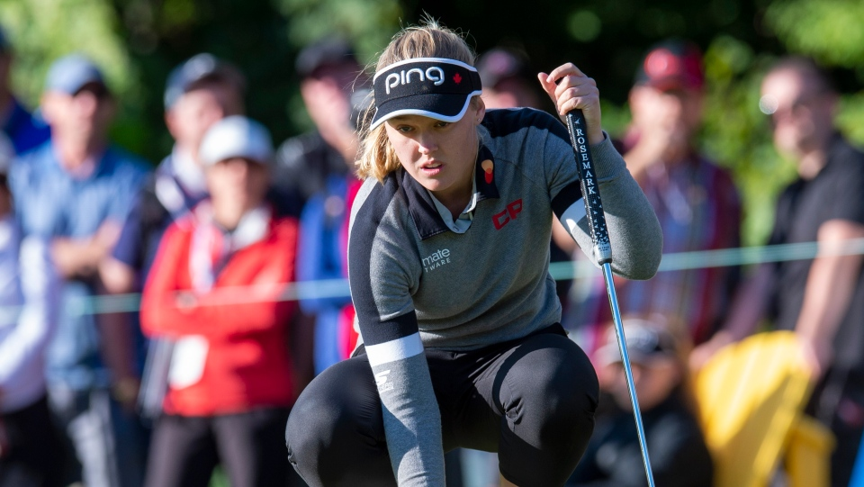 FILE - Brooke Henderson of Smith's Falls, Ont. lines up her putt on the second hole during the first round of the CP Women's Open in Aurora, Ontario, on Thursday August 22, 2019. THE CANADIAN PRESS/Frank Gunn