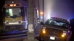 In this image from video, a light rail train, left, sits after derailment in Sacramento, Calif., Thursday night, Aug. 22, 2019. Authorities say more than two dozen people have been injured in the light rail train derailment in Northern California. (KOVR via AP)