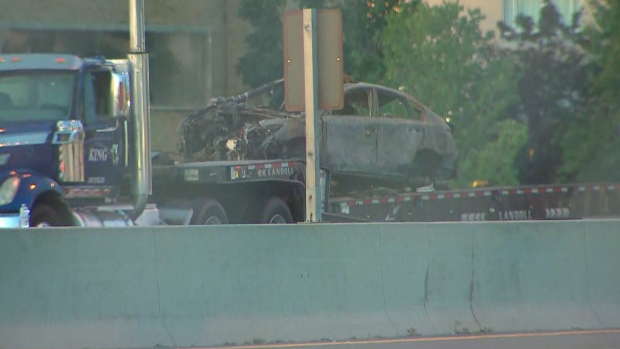 A car involved in a serious collision on the QEW at Trafalgar Road is shown. (CTV News Toronto)