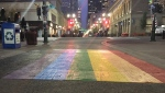 The permanent pride flag crosswalk at the intersection of Stephen Avenue and Centre Street South