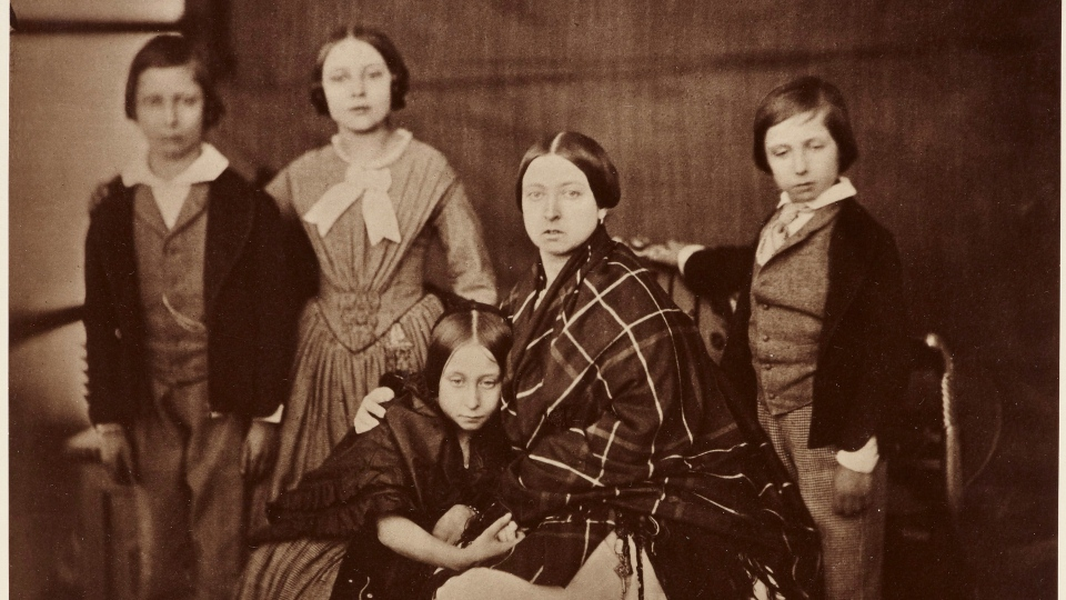 This undated image issued on Friday Aug. 23, 2019 by The Royal Collection shows an 1880 copy of the portrait of Queen Victoria with her four eldest children on 8 February 1854. Queen Victoria commissioned a set of private family photographs to be taken at Buckingham Palace in May 1854, including a portrait of showing the Queen draped in a tartan shawl, a pair of scissors tied at her waist, and clutching Princess Alice tightly. (The Royal Collection Trust via AP)