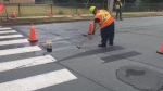 City crews remove a so-called 3D crosswalk from a Dartmouth street on Aug. 22, 2019.