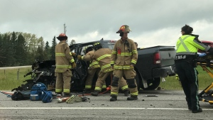 Cremona Fire Department and EMS at the scene of Friday morning's crash on Highway 22, south of Cremona (Justin McKinney)