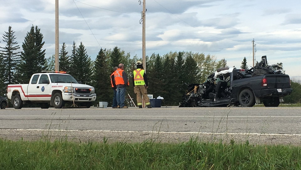 A severely damaged pickup truck on Highway 22 following Friday morning's crash south of Cremona