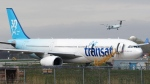 An Air Transat plane is seen as an Air Canada plane lands at Pierre Elliott Trudeau International Airport in Montreal on May 16, 2019. THE CANADIAN PRESS/Ryan Remiorz