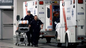 File image of paramedics with two ambulances.