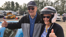 Al and Jan Davey were among the seniors who got to take a spin around Castrol Raceway in a high-powered luxury vehicle. (CTV)