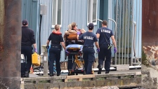 A woman is taken away on a stretcher after a boating accident on Indian Arm on Aug. 23, 2019.