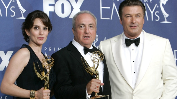 Tina Fey, executive producer Lorne Michaels and Alec Baldwin pose with the award for outstanding comedy series for their work on '30 Rock' at the 59th Primetime Emmy Awards. (AP / Reed Saxon)