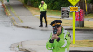 A cardboard cut-out of former North Vancouver RCMP Const. Matt McCoy is seen in the foreground. (RCMP photo)