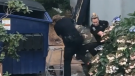 A still image from video posted to Reddit shows two members of the Vancouver Police Department attempting to arrest a suspect. The incident left both officers injured.