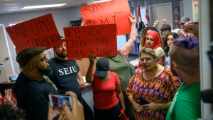 Demonstrators chant in MP Andy Fillmore's constituency office advocating for a stay on the deportation of Abdilahi Elmi to Somalia during a protest in Halifax on Tuesday, August 20, 2019. (THE CANADIAN PRESS / Darren Calabrese)