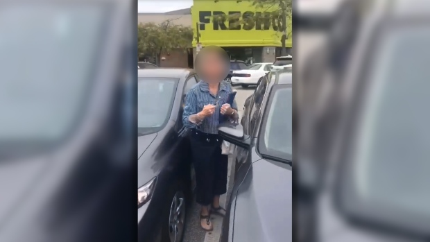 Richmond Mounties are investigating a video of a woman going on a racist rant in a mall parking lot.