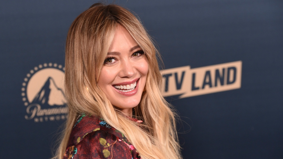 "Hilary Duff, a cast member in the TV Land television series ""Younger,"" poses at the Paramount Network, Comedy Central, TV Land Press Day 2019 at the London West Hollywood, Thursday, May 30, 2019, in West Hollywood, Calif. Duff will be reprising her role as Lizzie in a Lizzie McGuire reboot on Disney Plus. (Photo by Chris Pizzello/Invision/AP)"