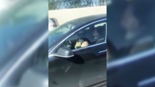 Alisha Olivier filmed what appears to be a man asleep in a vehicle as it cruises unassisted down a California freeway, raising questions of the responsibilities of drivers in self-driving cars.