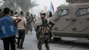 In this Friday Aug. 9, 2019 frame grab from video, Southern Transitional Council separatist fighters prepare to storm the presidential palace in the southern port city of Aden, Yemen. Forces loyal to Yemen's government took control of a headquarters and three military camps from the separatist militia on Saturday, Aug. 24. (AP Photo)