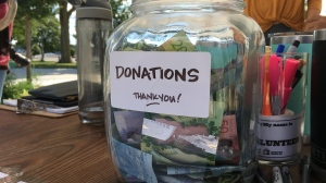 A donation jar is set up at a silent auction at Western Fair Market on Saturday, Aug. 24, 2019. (Brent Lale / CTV London)