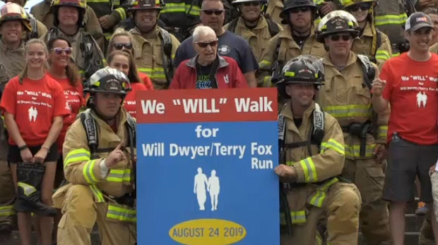 Will Dwyer is seen with firefighters from Base Borden.