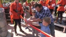 Bradley Aschenbrenner and his two sons cut the ribbon to officially open the Sarah Beckett Memorial Playground in Langford. Beckett, Aschenbrenner's wife and the boys' mother, was killed by a drunk driver in 2016. (CTV Vancouver Island)