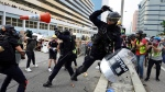 "Police and demonstrators clash during a protest in Hong Kong, Saturday, Aug. 24, 2019. Chinese police said Saturday they released an employee at the British Consulate in Hong Kong as the city's pro-democracy protesters took to the streets again, this time to call for the removal of ""smart lampposts"" that raised fears of stepped-up surveillance. (AP Photo/Vincent Yu)"