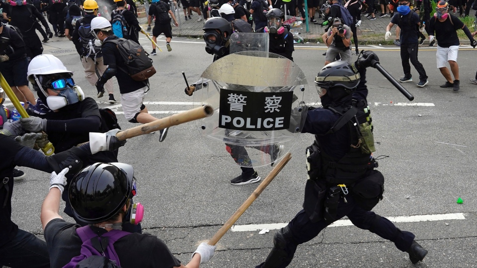 Police and demonstrators clash during a protest in Hong Kong, Saturday, Aug. 24, 2019. (AP Photo/Vincent Yu)