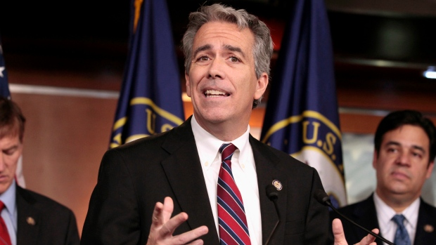 In this Nov. 15, 2011, file photo former U.S. Rep. Joe Walsh, R-Ill., gestures during a news conference on Capitol Hill in Washington. (AP Photo/Carolyn Kaster, File)