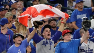 Toronto Blue Jays fans cheer during the sixth inning of the team's baseball game against the Seattle Mariners, Saturday, Aug. 4, 2018, in Seattle. (AP Photo/Ted S. Warren)