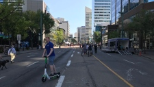 The first-ever Open Streets was set to feature live music, food trucks, an e-scooter obstacle course and a yoga class on the middle of Jasper Avenue.